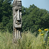 BRYAN EATON/ Staff Photo. The totem pole at the entrance to Battis Farm, which is host to Amesbury Community Garden, appears to be scowling, perhaps because unofficial summer is set to end Monday on Labor Day.