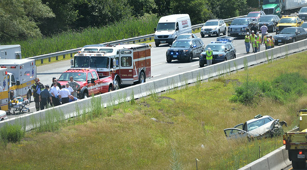 BRYAN EATON/ Staff Photo. Traffic was backed up on the northbound lane of Interstate 95 in Salisbury just south of the Main Street overpass as emergency crews transported two people of this car that flipped into the median.