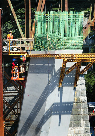 BRYAN EATON/ Staff Photo. Good views of the new Whittier Bridge construction can be seen from parts of Moseley Woods in Newburyport. A construction crew can be seen working on this support tower on the sound end of the bridge.