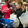 BRYAN EATON/ Staff Photo. Katie Munroe and Alana Jones of the Black Duck Market and Deli put a customers purchases into plastic bags. The Newburyport city council has passed an ordinance banning such bags that are of a thin material with handles.