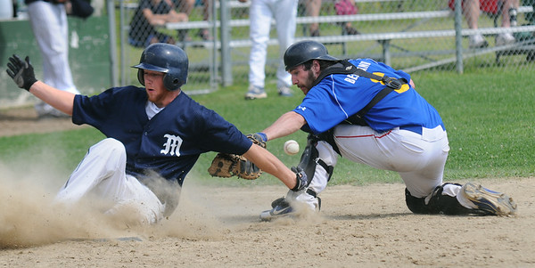 JIM VAIKNORAS/staff photo  Rowley Ram's Mark Berklander is late with a tag on Manchester Essex player Pete Clark at Eiras Field in Rowley.