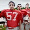 BRYAN EATON/ Staff Photo. Amesbury High football captains, from left, Travis Motsis, Spencer Fournier and Patrick Scanlon.