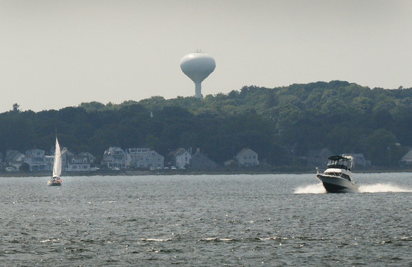 BRYAN EATON/ Staff Photo. A sailboat and power boat move along the Merrimack River on Tuesday afternoon, with more vessels in the mouth. The rest of the week look good for water activities, the weather getting more comfortable starting Thursday.
