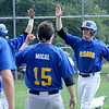 JIM VAIKNORAS/staff photo  Rowley Ram's Zach Rice celebrates scoring a run agianst Manchester Essex at Eiras Field in Rowley.
