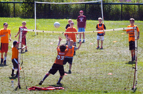 BRYAN EATON/Staff photo. Youngsters in the Multi Sport Camp put on by USA Sport Group through Newburyport Youth Services at the Perkins Playground play a form of handball on Thursday. Today is the last day of the NYS Summer Camps.