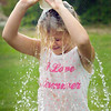 BRYAN EATON/Staff photo. Star Mispilkin, 6, of Newburyport dumps a cup of water over her head at the Boys and Girls Club in Salisbury. They were doing a relay race with each dumping the water then running back to tag the next teammate.