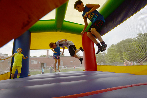 BRYAN EATON/Staff photo. Youngsters take turns in the Bouncy House at the Boys and Girls Club in Salisbury on Thursday afternoon. They were having an end of summer carnival.