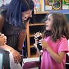 BRYAN EATON/Staff photo. Lavinia Minkowsky, 7, meets teacher Joanna Dodier at a Meet and Greet at the Cashman School in Amesbury yesterday. Dodier will be her second grade teacher when classes start in Amesbury today.