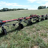 BRYAN EATON/Staff photo. A tedder, which turns mowed hay to dry, sit in one of the fields at Woodsom Farm. Hay is slow to grow with the drought and could be more expensive this year.