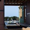 BRYAN EATON/Staff photo. The Lisa Ann IV fishing boat is framed by the new harbormasters building under construction on Newburyport's waterfront. The rededication of the Fisherman's Memorial will be held on September 5 on the site.