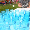 BRYAN EATON/Staff photo. Sadie Deveau, 8, of Salisbury tries her luck at water pong yesterday at the Boys and Girls Club during their end of season carnival. Today is the end of their summer program.