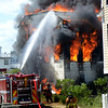 JIM VAIKNORAS/Staff photo Firefighters battle a blaze on Plum Island Saturday afternoon.