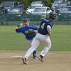 JIM VAIKNORAS/Staff photo Rowley's CJ Ingraham turns a double play vs Manchester at Eiras Field in Rowley as Manchester's Caulin Rogers brakes off his run to second.