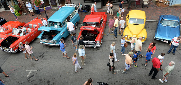 BRYAN EATON/Staff photo. Automobiles of all colors line Pleasant Street in downtown Newburyport as people from all over the area came to vintage vehicles.