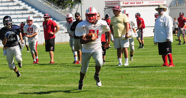 JIM VAIKNORAS/Staff photo Amesbury's #Qach Levarity runs a reverse  during a scrimmage against Greater Lowell