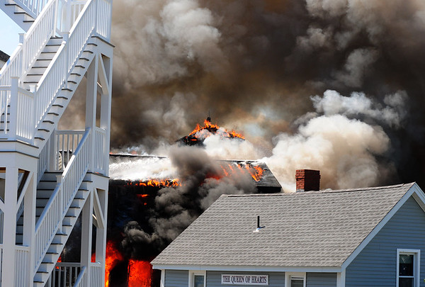 JIM VAIKNORAS/Staff fire: Flames engulf the copola on the roof of a home on 20th Street on Plum Island.