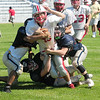 JIM VAIKNORAS/Staff photo Amesbury's #49 Danny Noons (sp?) runs for yardage during a scrimmage against Greater Lowell