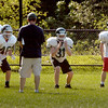 BRYAN EATON/Staff photo. Pentucket High football defensive line go through drills.