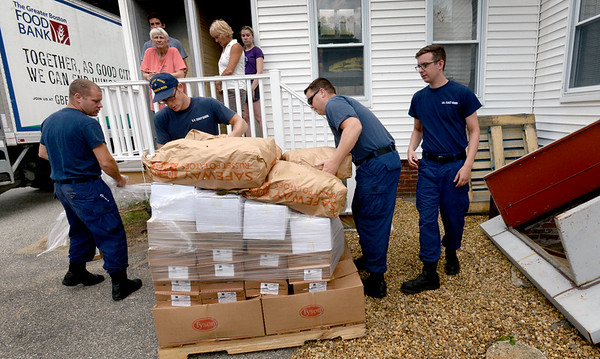 BRYAN EATON/Staff Photo. The Pettengill House in Salisbury has some new volunteers, members of the U.S. Coast Guard at Station Merrimack, who help with huge loads of food. They were on hand Friday to unload 6,000 pounds of food from the Greater Boston Food Bank.