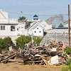 JIM VAIKNORAS/Staff photo All that's left of a home Sunday morning on 20th Street on Plum Island after a fire Saturday afternoon