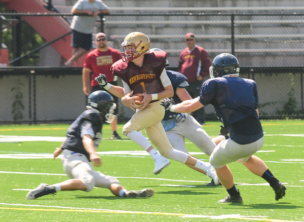 JIM VAIKNORAS/Staff photo Newburyport's #1  running against Wilmington in a scrimmage at World War Memorial Stadium.