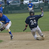 JIM VAIKNORAS/Staff photo Rowley's CJ Ingraham waits for the throw as Manchester Rory Gentile at Eiras Field in Rowley.