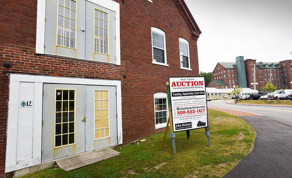 BRYAN EATON/Staff photo. The building some hoped would be a carriage museum in Amesbury's Lower Millyard is up for auction.