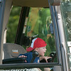 JIM VAIKNORAS/Staff photo Nicholas Demeritt, 2, checks out a front end loader at Merrimac Old Home Day at the Donahue School Saturday morning. The all day event included, face painting, a mechanical bull, strawberry shortcake, a bike parade, a road race, and much more.