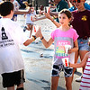 BRYAN EATON/Staff photo. Maria Greco, 9, left, and her sister, Vivian, 4, of Newburyport hand out water to the runners in front of the Starboard Galley on Water Street.