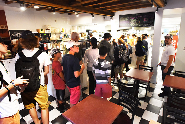BRYAN EATON/Staff photo. Customers line up inside Abe's which is about the same layout and seating and is brighter than it was.