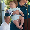 JIM VAIKNORAS/Staff photo State Senator Kathleen O'Connor Ives hold her son Ronen as she speaks at Yankee Homecoming's  Old Fashioned Sunday on the Bartlet Mall in Newburyport Sunday. Ronen is waving a small Yankee Homecoming flag.