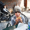 BRYAN EATON/Staff photo. Cal Eaton, 8, of Newburyport enjoys his bagel in the patio area.
