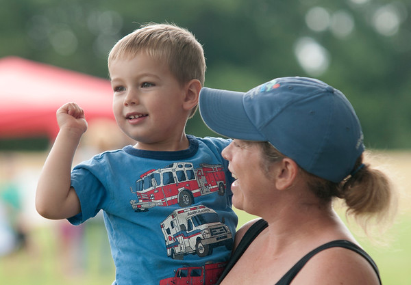 JIM VAIKNORAS/Staff photo Crosby Altieri, 3, and his mom Beth Card enjoy a performance by the Stacey Peasley Band during Family Day at Maudslay Saturday morning.