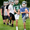 BRYAN EATON/Staff photo. Pentucket High football players limber up during practice on Friday.