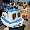 "BRYAN EATON/Staff photo. Thomas Loring, 3, of Merrimac was quite taken with ""Coastie"" a talking and moving boat run by remote control. The robot talks about boating and water safety and is run by the US Coast Guard Auxilliary."
