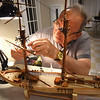 BRYAN EATON/Staff photo. In addition to seeing many model ships  featured by Merrimack Valley Ship Model Club, people got to see one being built. Robin Neill of Salem, N.H. creates a replica of the US Revenue Cutter Jefferson Davis, who was Secretary of War before the Civil War.