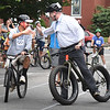BRYAN EATON/Staff photo. State Rep. James Kelcourse, right, congratulates David Turturro of the Newburyport Bank in winning this heat of the Slow Bike Race.