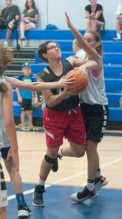JIM VAIKNORAS/Staff photo Kya Buedier of the Road Runners drives to the basket at the Cam Coye 3on3 basketball tournament at Georgetown High School Saturday.