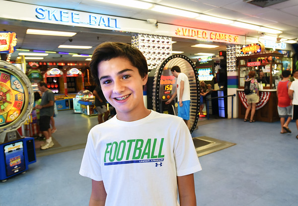 BRYAN EATON/Staff photo. Jacob Prunier, 13, at Joe's Playland at Salisbury Beach.