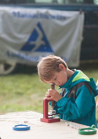 JIM VAIKNORAS/Staff photo Leo Oaks, 6, of Amesbury uses one of the  microscopes brought by the Joppa Education Center during Family Day at Maudslay Saturday morning.
