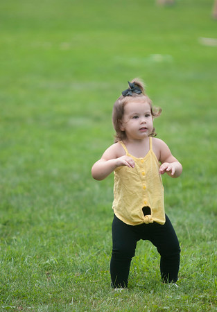 JIM VAIKNORAS/Staff photo Emerson Roberts, 18 months, dances as she makes her way around Merrimac Old Home Day at the Donahue School Saturday morning. The all day event included, face painting, a mechanical bull, strawberry shortcake, a bike parade, a road race, and much more.