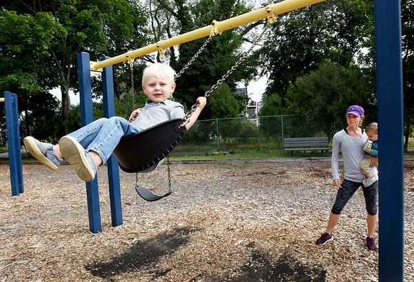 BRYAN EATON/Staff photo. Charlie Crape, 3, of Newburyport at the playground at Perkins Park with brother, Bryce, 1, and babysitter Sarah Selig.