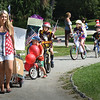 BRYAN EATON/Staff photo. Youngster participate in the Bicycle and Carriage Parade at Kids Day in the Park at Atkinson Common.