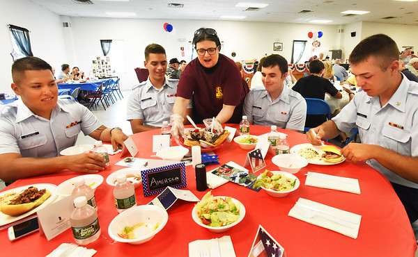 BRYAN EATON/Staff photo. Donna Jarvis served members of U.S. Coast Guard Station Merrimack at the Veteran's Luncheon at FIremen's Memorial Hall in Newbury. From left, Seaman Christian Hernandez; Petty Officers Gregory Vargas, Chris Dugas and Max Balint.