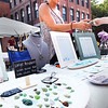 BRYAN EATON/Staff photo. Renee Vartabedian of Newburyport makes a sale of her handcrafted seaglass jewelry at the Market Square Craft Show.