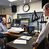 BRYAN EATON/Staff photo. Longtime WNBP radio announcer and newsman Win Damon interviews Salisbury town manager Neil Harrington during his last broadcast on Monday morning. The station has been sold and Damon is not being retained by the unknown new owners and it is unclear the status of other personnell.