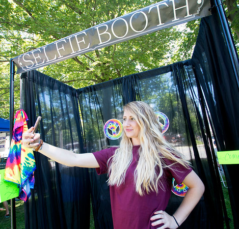 JIM VAIKNORAS/Staff photo   Volunteer Shannon Ouellette take a selfie as she runs the Selfie Booth at Old Fashioned Sunday on Mall in Newburyport Sunday.