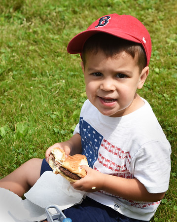 BRYAN EATON/Staff photo. Logan Vien, 2, of Haverhill, whose mother Jackie works at the Anna Jaques Hospital, enjoys a hamburger at Kids Day in the Park which is sponsored by the Exchange Club of Newburyport.