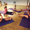 BRYAN EATON/Staff photo. Paula Wilson of Harmony Yoga teaches a class to youngsters.