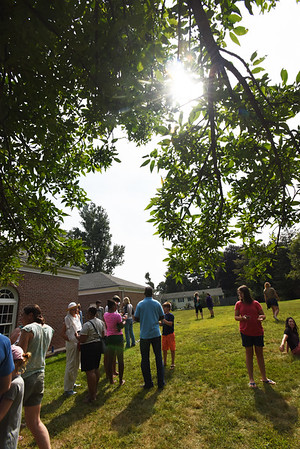 BRYAN EATON/Staff photo. Over 100 people gathered at the G.A.R. Memorial Library in West Newbury to view the solar eclipse.